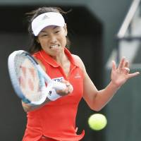 Kimiko Date hits a shot during her first-round match on Wednesday in Gifu. | KYODO