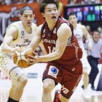 The Brave Thunders' Naoto Tsuji looks to make a play as the Sunrockers' Leo Vendrame defends in Game 1 of their B. League Championship quarterfinal series on Saturday in Hiratsuka, Kanagawa Prefecture. Kawasaki won 89-75. | KYODO