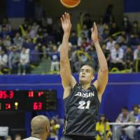 Mikawa's Gavin Edwards takes a fourth-quarter shot against Ryukyu in Game 1 of their B. League Championship quarterfinal series on Saturday. The SeaHorses won 76-72, getting 18 points, 13 rebounds and four blocks  from Edwards.   B. LEAGUE