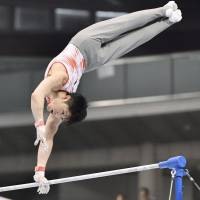 Two-time Olympic all-around champion Kohei Uchimura competes during the NHK Cup on Sunday at Tokyo Metropolitan Gymnasium. | KYODO