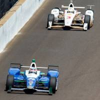 IndyCar Series driver Takuma Sato (26) leads Helio Castroneves (3) during the final laps of the 101st Running of the Indianapolis 500 at Indianapolis Motor Speedway Sunday. | GUY RHODES / VIA USA TODAY SPORTS
