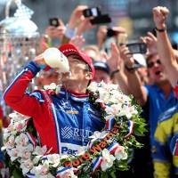 Takuma Sato takes the traditional drink of milk after winning the Indianapolis 500 on Sunday. | USA TODAY / VIA REUTERS