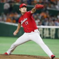 Carp hurler Okada gets big support from offense, holds Giants in check