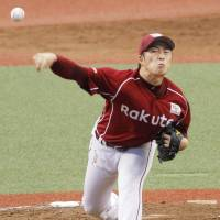 The Eagles' Manabu Mima fires a pitch during Saturday afternoon's game against the Lions at MetLife Dome. Mima pitched eight innings of two-run ball as Tohoku Rakuten defeated Seibu 10-2.   KYODO