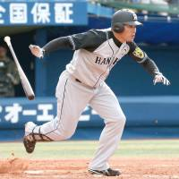 Hanshin's Kosuke Fukudome runs for first base after getting a hit in the ninth inning of the Tigers' 4-2 win over the BayStars on Sunday. | KYODO