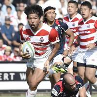 Japan's Shota Horie scores a second-half try against Hong Kong on Saturday at Prince Chichibu Memorial Rugby Ground. Japan won 29-17. | KYODO