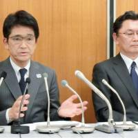 Japan Tennis Association officials Tsuyoshi Fukui (left) and Hajime Takahashi speak to reporters during a news conference on Wednesday evening. | KYODO