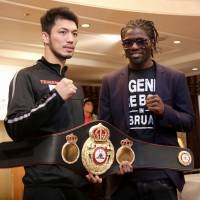 Middleweights Ryota Murata (left) and Hassan N'Dam pose for photos on Thursday, two days before their WBA title bout in Tokyo. | KAZ NAGATSUKA