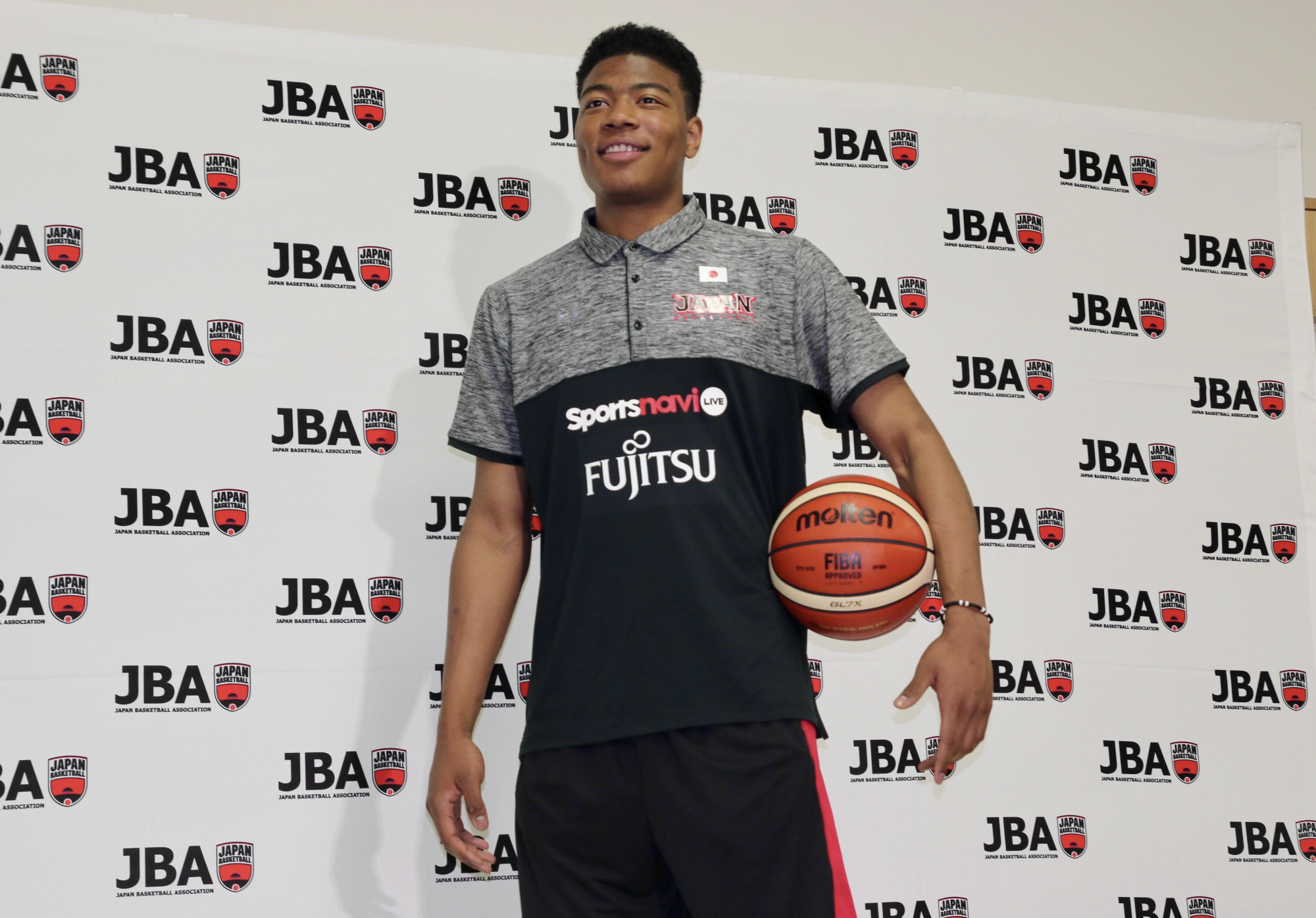 Rui Hachimura poses for photos at Tokyo's National Training Center on Friday following a news conference. | KAZ NAGATSUKA