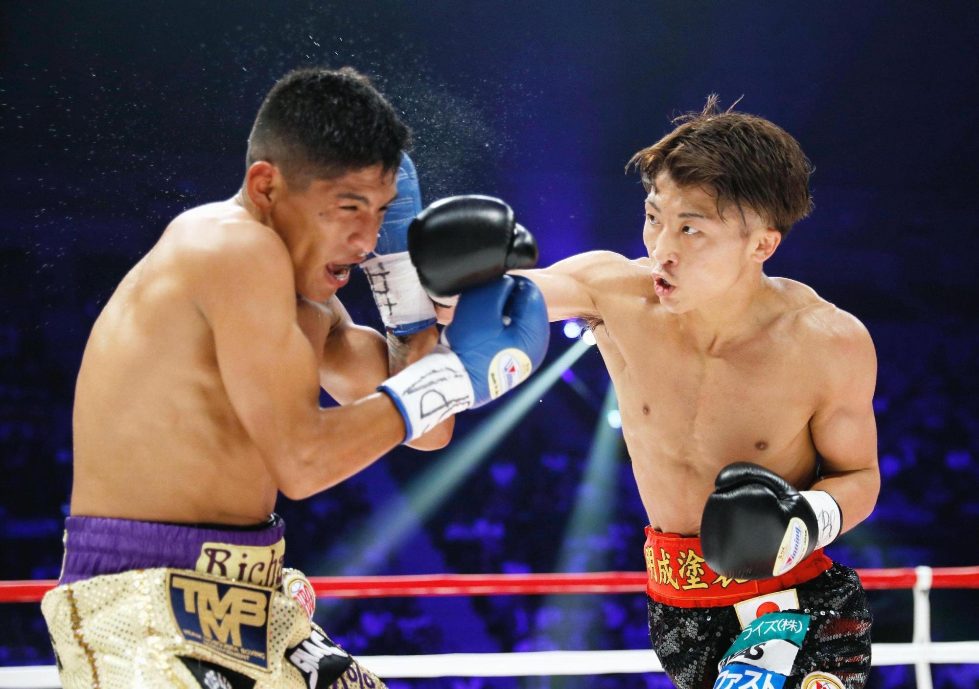 WBO super flyweight champion Naoya Inoue (right) punches challenger Ricardo Rodriguez during the second round of their title bout on Sunday at Ariake Colosseum. | KYODO