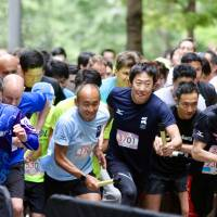 Japan Sports Agency commissioner Daichi Suzuki (3701) and other runners begin the Square Mile Relay at Tokyo's Marunouchi district on Friday evening. | KAZ NAGATSUKA