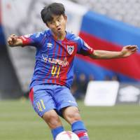 Fifteen-year-old Takefusa Kubo takes a free kick during his debut with FC Tokyo's first team on Wednesday. | KYODO