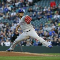 Rangers outlast Mariners in 13th
