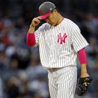 Yankees pitcher Masahiro Tanaka reacts during the first inning of New York's lost to Houston on Sunday night at Yankee Stadium. | USA TODAY / VIA REUTERS