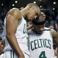 Grieving Thomas carries Celtics in Game 1