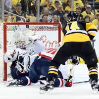 Capitals edge Penguins in OT; Crosby injured