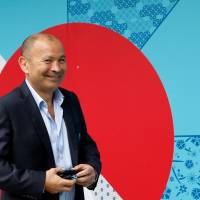England head coach Eddie Jones arrives at Kyoto State Guest House for the pool draw for the 2017 Rugby World Cup on Wednesday. | REUTERS