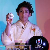 Olympic wrestling great Saori Yoshida participates in the 2019 Rugby World Cup draw on Wednesday.   REUTERS