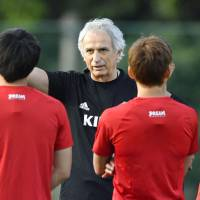 National team manager Vahid Halilhodzic instructs his players during a training session for the squad's overseas-based players in Chiba on Sunday. | KYODO