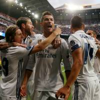 Ronaldo hat trick puts Real Madrid on brink of Champions League final