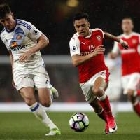Arsenal takes top-four race down to wire