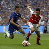 Cup glory gives Wenger respite