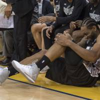 Spurs forward Kawhi Leonard reacts after being injured during Game 1 of the Western Conference finals on Sunday in Oakland, California. | USA TODAY / VIA REUTERS