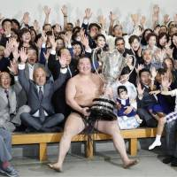 Yokozuna Hakuho and his supporters celebrate his 38th career title after the Summer Grand Sumo Tournament wrapped up on Sunday at Ryogoku Kokugikan. | KYODO