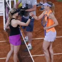 Fired-up Bouchard prevails over Sharapova in Madrid Open showdown