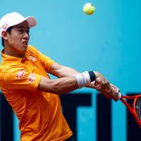 Kei Nishikori plays a shot during his third-round match against David Ferrer at the Madrid Open on Thursday. | AFP-JIJI