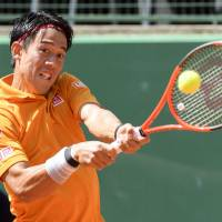 Kei Nishikori plays a shot from South Africa's Kevin Anderson in their quarterfinal match at the Geneva Open on Thursday. Nishikori won 2-6, 6-4, 7-6 (8-6). | AP