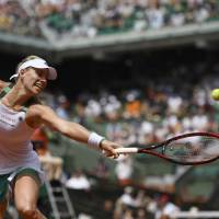 Daniel wins in first round; Kerber upset