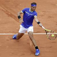 Djokovic, Nadal cruise into second round