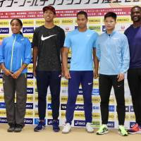 Hakim Abdul Sani Brown (third from left), Aska Cambridge (fourth from left), Justin Gatlin (right) and other athletes pose for a photo on Saturday. | KAZ NAGATSUKA
