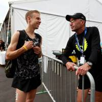 Coach Alberto Salazar (left), seen here with American distance star Galen Rupp, is denying recent doping allegations in a report by the U.S. Anti-Doping Agency. | AP