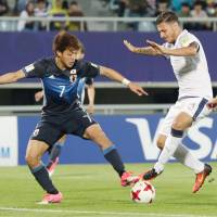 Japan's Ritsu Doan (left) controls the ball before his scoring his second goal of the game in Saturday night's 2-2 draw with Italy at the Under-20 World Cup in Cheonan, South Korea.   KYODO