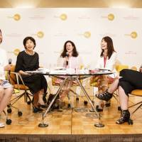 Panelists speak during a round-table session at last year's conference. | EWOMAN, INC.