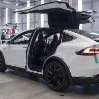 Tesla Inc.'s Model X sport utility vehicle equipped with automatic braking is seen at the automaker's Tilburg, Netherlands, factory in December. | BLOOMBERG