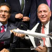 Vice President of Boeing Commercial Airplanes Ihssane Mounir (left) celebrates with United Airlines Senior Vice President of finance Gerry Laderman during a commercial announcement at the 52nd Paris Air Show at Le Bourget Airport near Paris Tuesday. | REUTERS