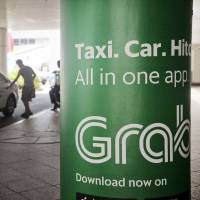 Uber rival Grab hunts for new deals with SoftBank funding