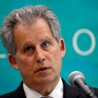 International Monetary Fund Deputy Managing Director David Lipton speaks at a news conference in Tokyo on Monday. | REUTERS