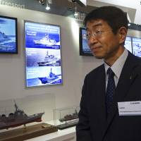 Shoji Sato, vice president and general manager at Mitsubishi Heavy Industries who is in charge of defense and space systems, at the maritime and air defense exhibit in Chiba Monday.   AP