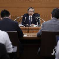 Bank of Japan Gov. Haruhiko Kuroda is seen as a contender to get a second term, according to the results of a survey released ahead of a policy meeting this week. | BLOOMBERG