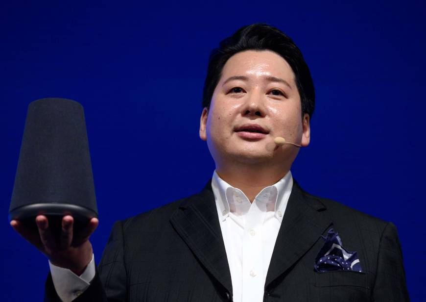 Jun Masuda, chief strategy and marketing officer of Line Corp., holds the company