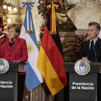 Merkel in Argentina hits protectionist Trump, talks trade and climate change
