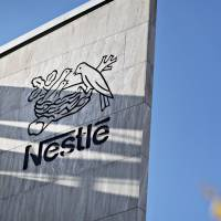 Nestle's birds nest logo is seen carved on a building at the firm's headquarters in Vevey, Switzerland. Activist investor Dan Loeb's hedge fund Third Point is targeting the firm. | BLOOMBERG