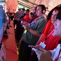 Gaming fans play 'Super Mario Odyssey' at the Los Angeles Convention Center on day one of E3 2017. | AFP-JIJI