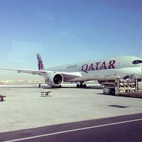 A parked Qatari plane is seen Tuesday in Hamad International Airport (HIA) in Doha. Qatar's foreign minister says Kuwait is trying to mediate a diplomatic crisis in which Arab countries have cut diplomatic ties and moved to isolate his energy-rich, travel-hub nation from the outside world. | AP