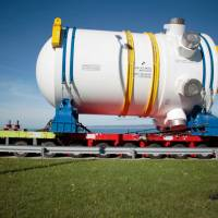 The reactor vessel, a major component of the third-generation European Pressurized Reactor (EPR), arrives at the construction site in Flamanville, northwestern France, in 2013. France's nuclear plant operator EDF last month said the Flamanville reactor — a project that has run into deep problems — will begin operations in 2019. | AFP-JIJI