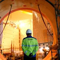 An EDF worker is seen on the construction site of the third-generation European Pressurised Water nuclear reactor (EPR) in Flamanville, France, Nov. 16. | REUTERS